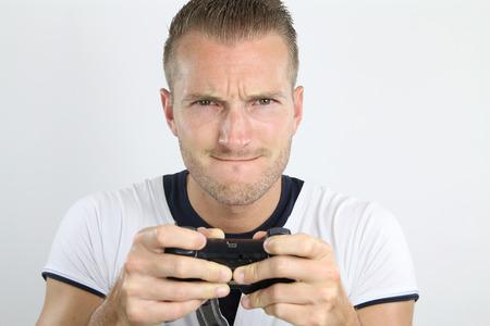 jugando videojuegos: j�venes adultos jugando juegos de video Foto de archivo