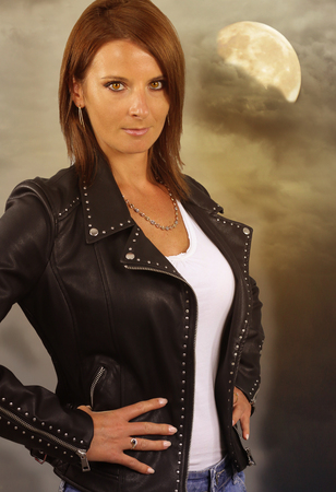 young werewolf - beautiful woman wearing a leather jacket Stock Photo