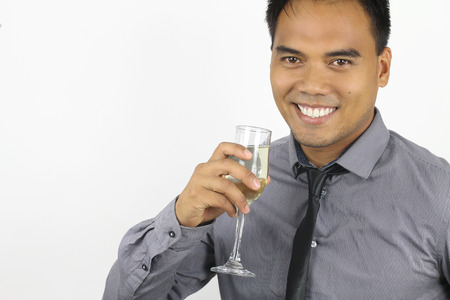 champagne flute: the new year - young filipino with a champagne flute