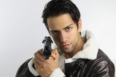 beau mec: beau mec tenant un fusil Banque d'images