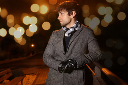 winter fashion: bokeh effect - elegant man During the night