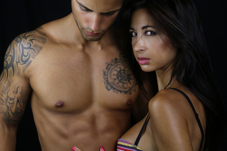 sexy couple black background: Couple wearing sexy underwear Stock Photo