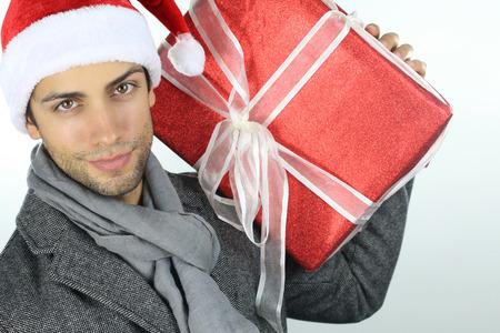 hombre con sombrero: man holding a christmas present