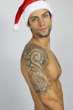 modelos desnudas: Apuesto joven de Santa Claus Foto de archivo