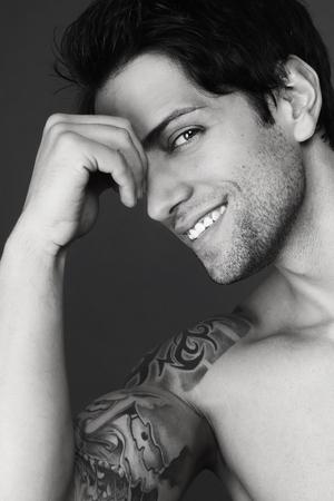man portrait: tattooed guy smiling