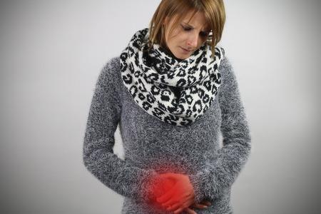 gastroenteritis: gastroenteritis - woman touching her belly