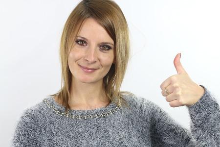raises: young woman raises her thumb Stock Photo