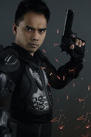 cops: super cops - asian man posing with a gun