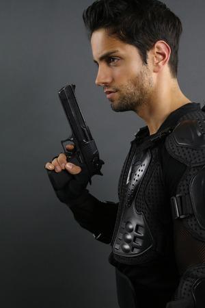super cops - handsome man posing with a gun Standard-Bild