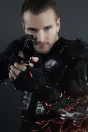 cops: super cops - blond man posing with a gun Stock Photo