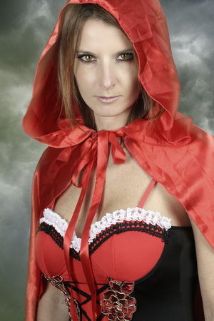 fictional character: Fictional character - young woman wearing a red Riding Hood Stock Photo