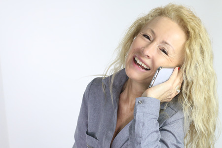 woman at the phone: mature smiling woman on a phone