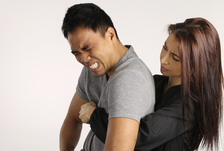 choking: Heimlich - Young woman rescue a man Stock Photo