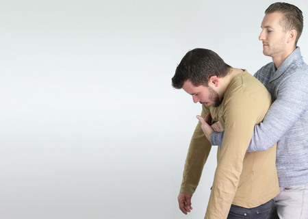 first aid: Heimlich - first aid gesture Stock Photo