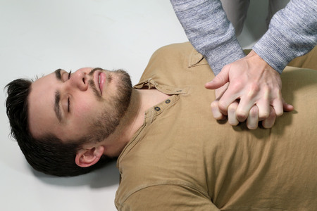 cpr: a man doing CPR over a white background