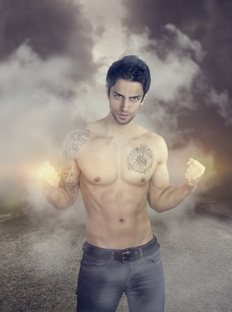 super hero - sexy man showing His power