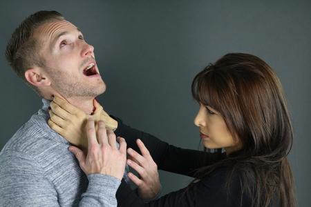strangling: young woman strangling her boyfriend