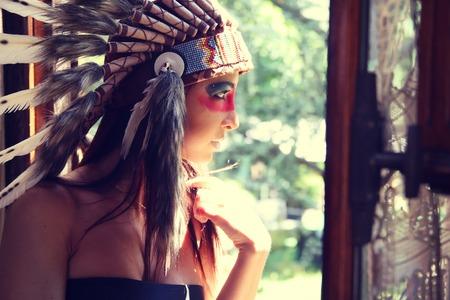indian headdress: Beautiful woman wearing an Indian headdress