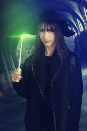 supernatural power: beautiful witch holding a magic wand