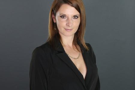 businesswoman suit: Beautiful businesswoman wearing a black suit