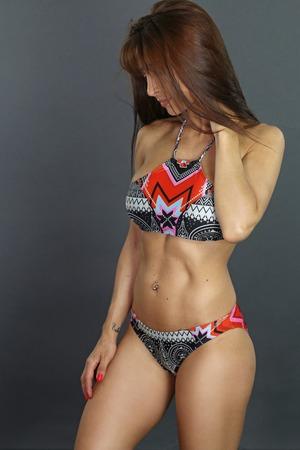 skimpy: muscular woman wearing a bikini