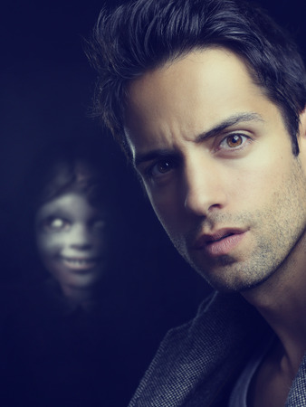 possesses: an evil doll and a man in a twilight