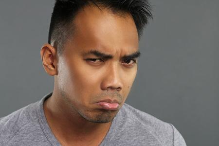 grumpy: Grumpy young man Stock Photo