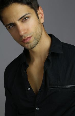 Portrait of an handsome male wearing a black shirt Standard-Bild