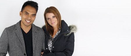 couple winter: Mixed Couple wearing winter jackets