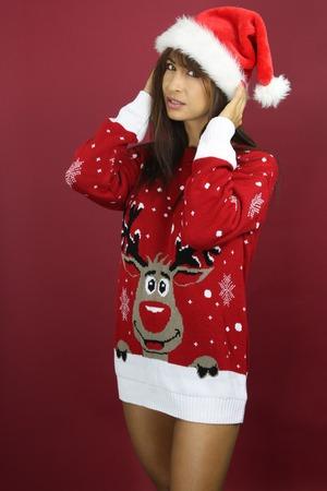 tacky: Beautiful woman wearing a tacky Christmas sweater