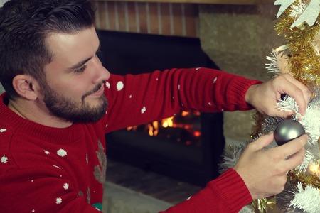 decorating christmas tree: Man decorating a Christmas tree