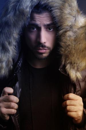 fur hood: Young man holding a fur hood Stock Photo