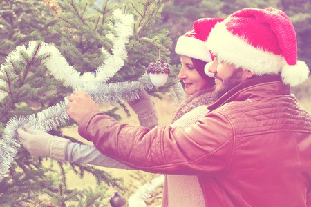 couples outdoors: Merry Christmas. Young couples celebrating Christmas outdoors