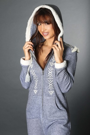 Beautiful woman wearing a pajama over a gray background 版權商用圖片