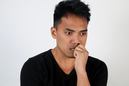 anguished: Portrait of a worried young man Stock Photo