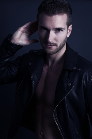 Handsome man wearing a black leather jacket Stock Photo
