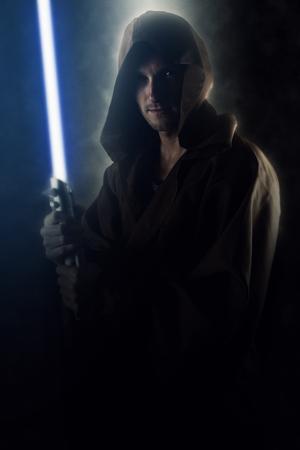 Young warrior holding a lightsaber Standard-Bild