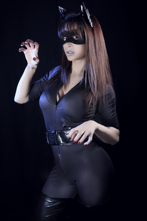 catwoman: Beautiful girl wearing a catsuit Stock Photo