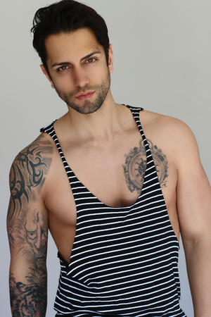 Handsome tattoed man wearing a tank top Stock Photo