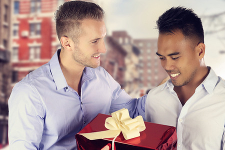 Two men gay couple exchanging a present