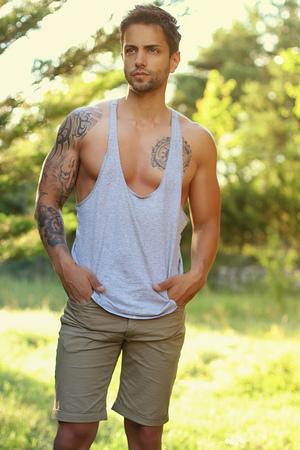 Trendy young man wearing a tank top