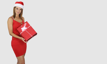 Beautiful woman holding a Christmas and New Year gifts on white background