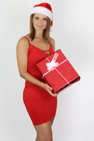 Beautiful woman holding a Christmas and New Year gifts.