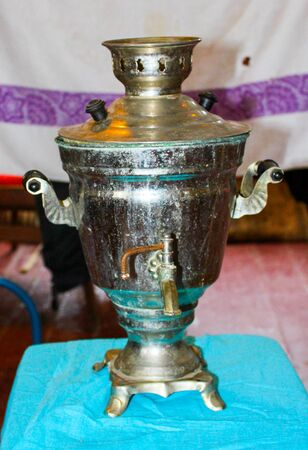 Museum of old objects old works of masters retro prodAn old Russian samovar stands on a table removed from its side ucts