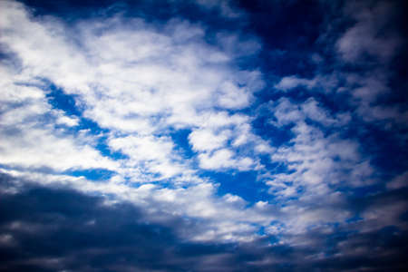 Spring March sky with white fluffy clouds Ukraine