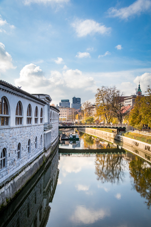 View of City channel with bridge in the background during a bright sunny day with blue sky, Ljubljana, Slovenia