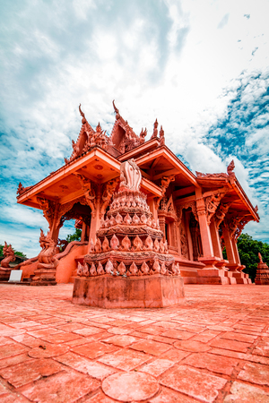 Snake Stone Red pagoda temple during a bright sunny day in Koh Samui, Surat Thani, Thailand