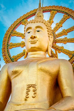 Big Buddha temple statue during a sunny bright day, Wat Phra Yai in Koh Samui, Surat Thani, Thailand Stock Photo