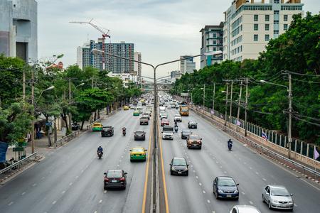 BANGKOK, THAILAND - JUNE 25, 2018: Busy road full of cars and motorbikes in center of Bangkok