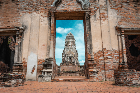 Historic ruins of ancient capital city of Thailand with temples during bright sunny day, Ayutthaya, Thailand